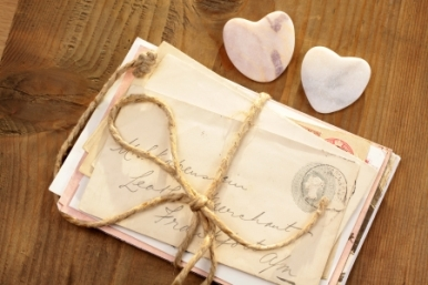 12775040 - stone hearts with old tied letters on wooden desk