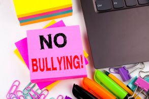 Writing text showing No Bullying made in the office with surroundings such as laptop, marker, pen. Business concept for Bullies Prevention Against School Work or Cyber Internet Harassment