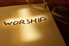 53556509 - book with word worship, cross  and glasses.
