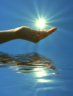 7322408 - hand holding sun and water reflaction with copyspace