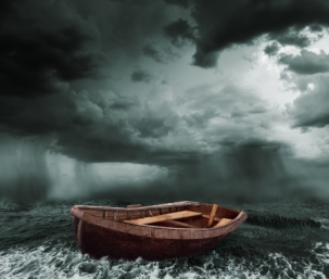 25225309 - old boat in the stormy ocean